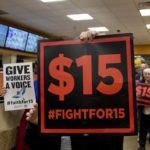 Supporters of a $15 minimum wage walk through a Dunkin' Donuts store during a rally at the Capitol on Tuesday, Nov. 10, 2015, in Albany, N.Y. The New York Senateís Republican leader is declining to endorse the $15 minimum wage backed by Gov. Andrew Cuomo, saying the issue will be discussed in detail by his conference and predicting ìsome kind of compromise.î (AP Photo/Mike Groll)